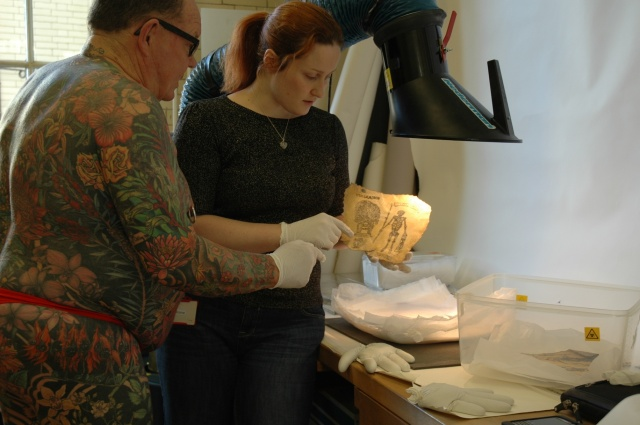 Showing Geoff one of the memorial tattoos in the collection.
